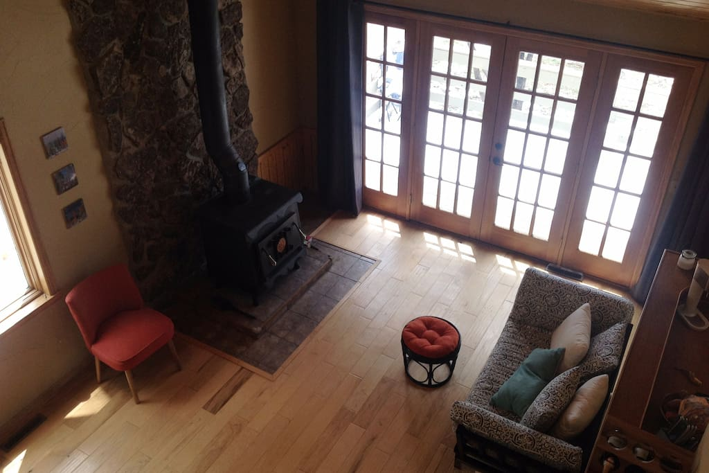 Sitting room with wood burning stove and lots of light
