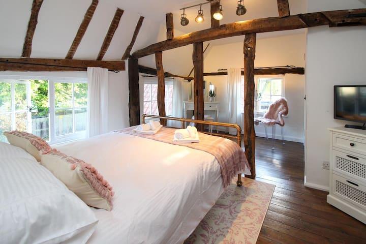 Both bedrooms have beautiful original wooden ceiling beams and rustic wooden flooring.