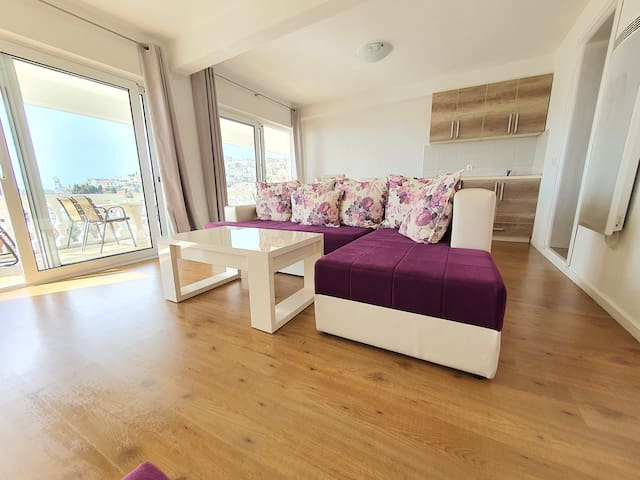 Spacious and bright living room with beautiful panoramic views of the sea and Old Town Fortress.