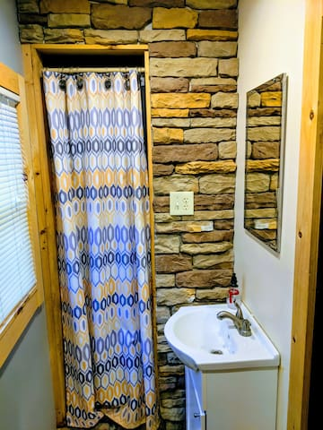 Stone Faced Shower area.