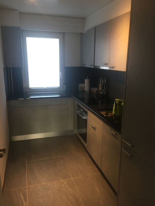 Newly renovated kitchen with coffee machine, oven, dish washer and all needed utensils.