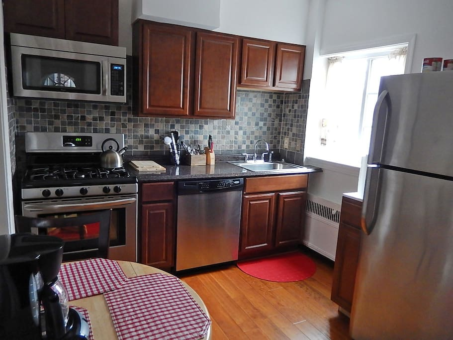 Updated kitchen with dinette set for 2, coffeemaker, coffee, tea, accessories, and more provided