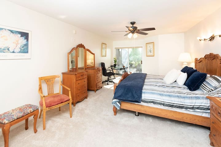 Large master bedroom with King Sized bed and computer desk