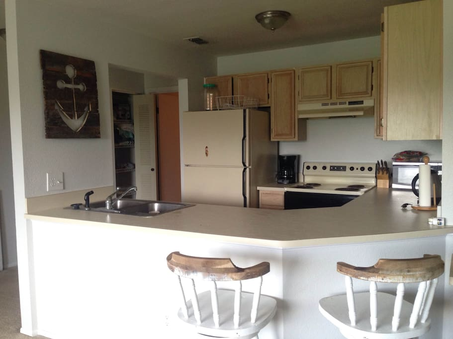 Open kitchen to living room with breakfast bar