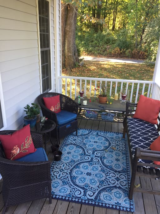 Porch chairs have slide out ottomans