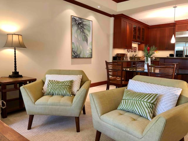 The spacious living and dining area - brand new carpet!  (new couch, chairs, and artwork in October 2019!)