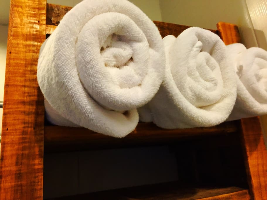 All sizes of Nice and clean towels has been set up in the clean and dry shelf. Very comfortable and fresh living in the bed room.