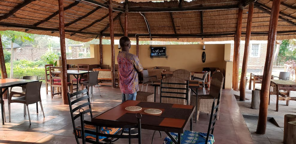 Traditional thatched roof open air restaurant where you can catch a match on the TV or enjoy the natural scenery.