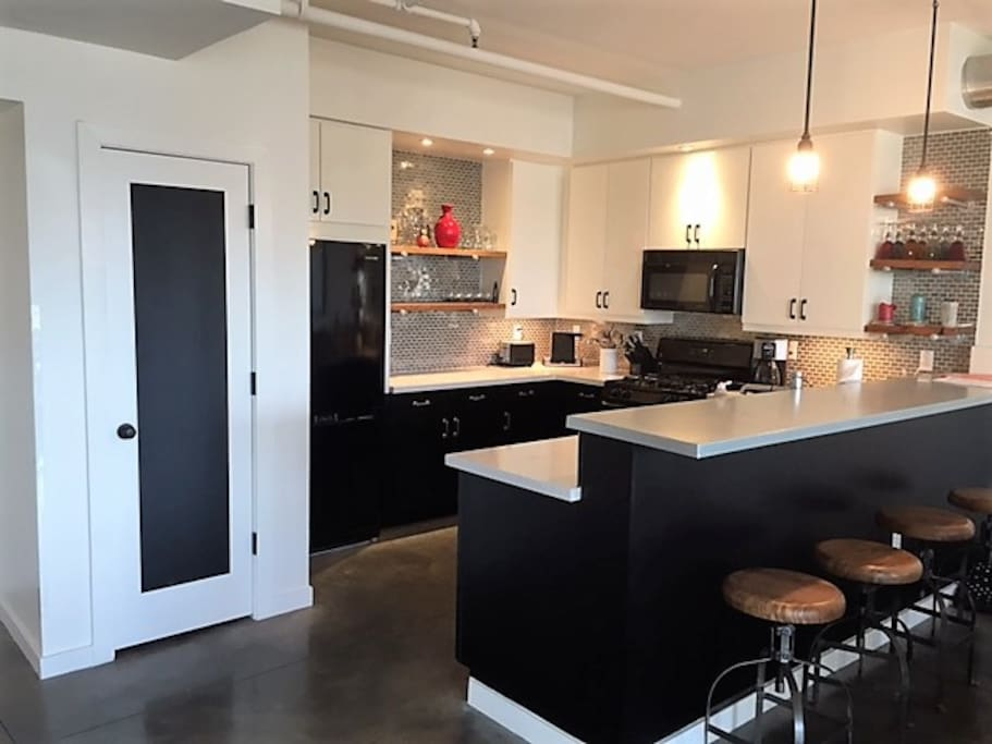 Contemporary industrial kitchen fully stocked for dining in