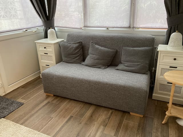 This is our sofa bed in our converted conservatory, with garden access.