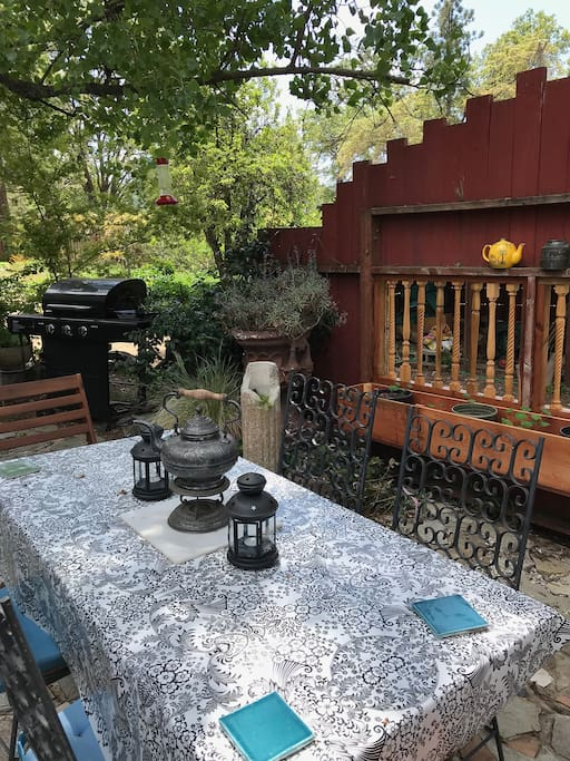 front patio dining area, BBQ, and garden