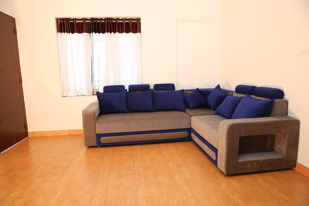 A living room well-furnished and designed for the purpose of lounging