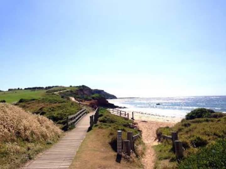 Large apt steps to beach, ocean pool & scenic walk