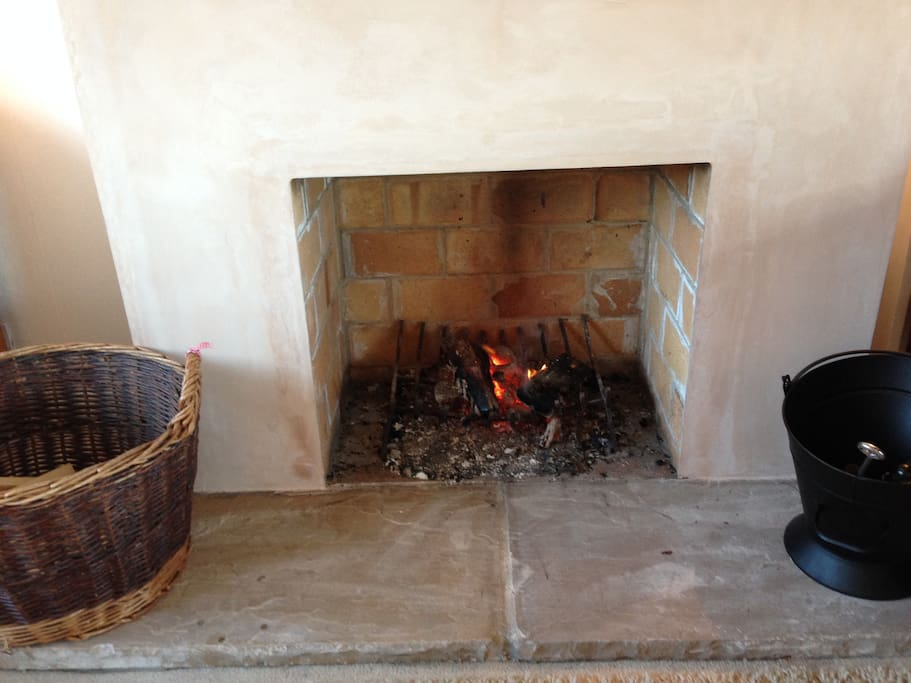 Large open fire, free supply of wood
