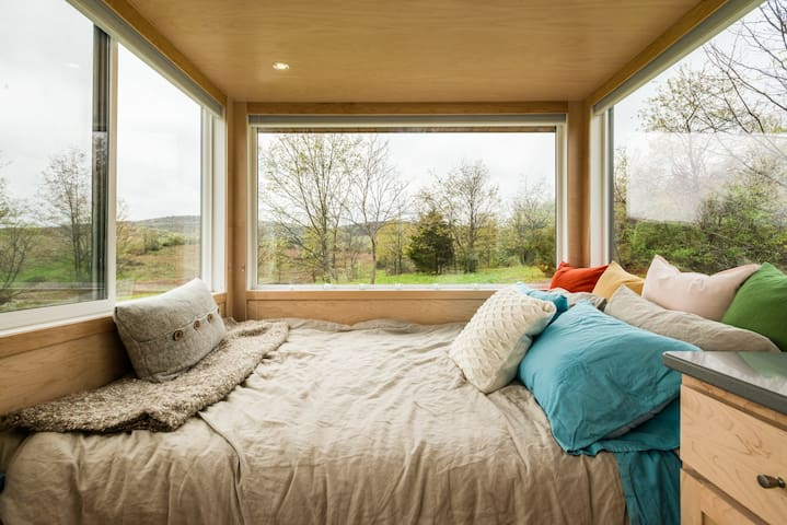 The glass lets you fall asleep while staring at stars, watch the sunset from bed, and wake up to the first rays of morning.