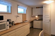 Microwave, oven, coffey machine, kettle, extra plates, kitchenette