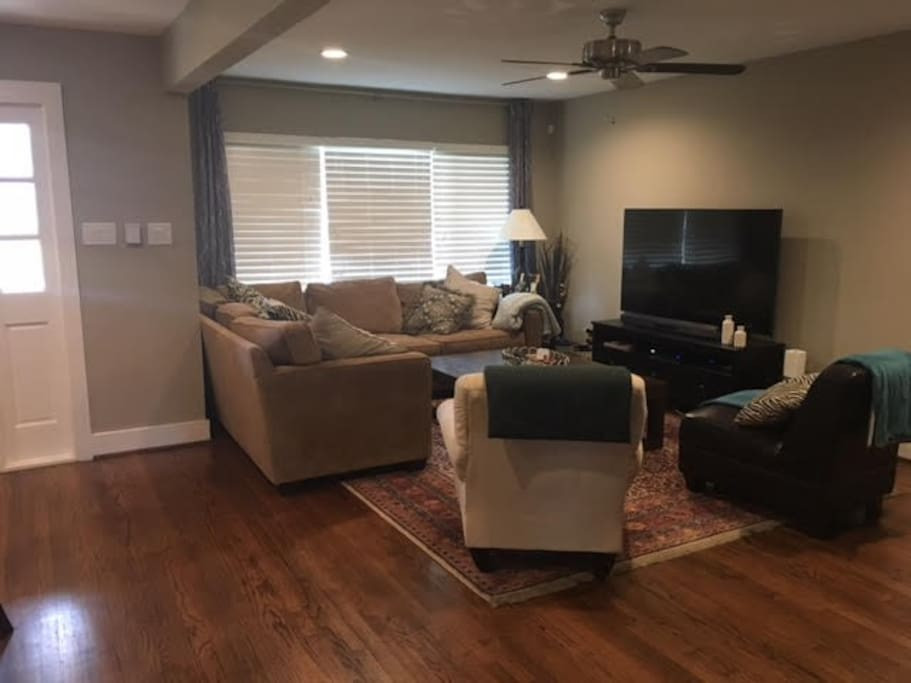 "Main Living Space with 65"" 4K TV and Large Sectional"