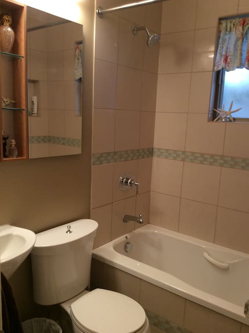 Towels, blow dryer, soap, shampoo, conditioner provided. Bathroom on main floor.
