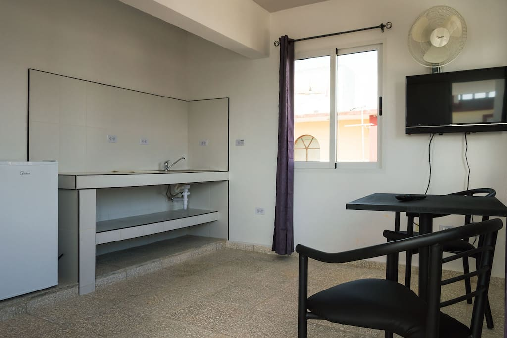 Living room and kitchen, minibar, TV