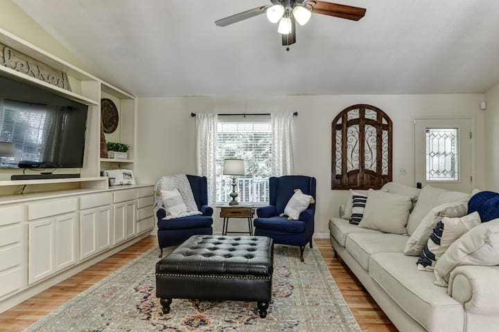 Relax in the living room with a sofa and two classic wingback chairs.  Equipped with HDTV, sound bar, and a suite of streaming services.