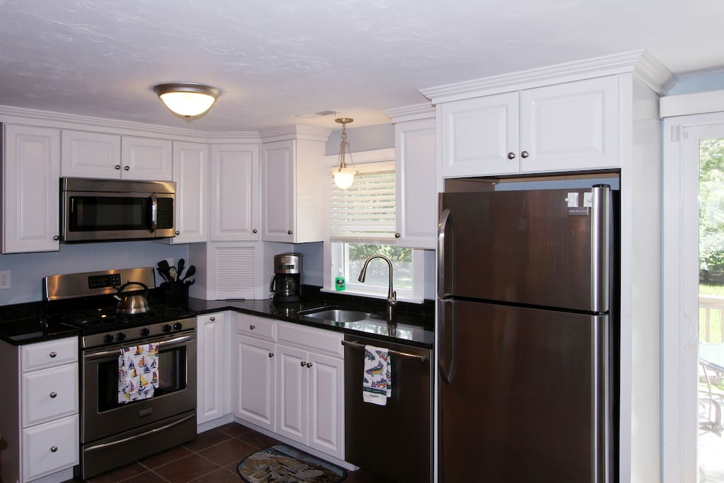 Fresh, updated kitchen with stainless appliances and new tiled floor.