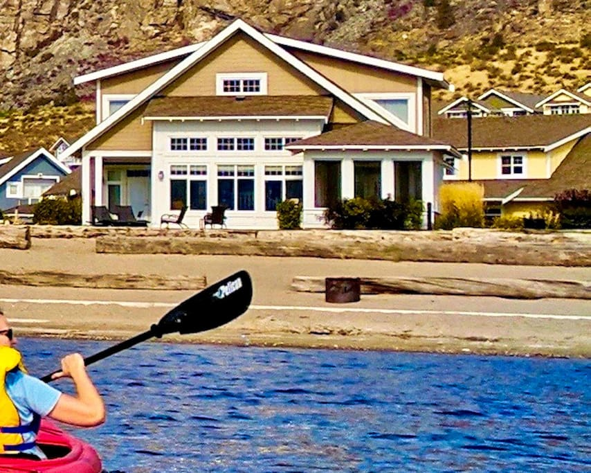 View of the Beach House Osoyoos from the lake.  Kayaks for you to use too!