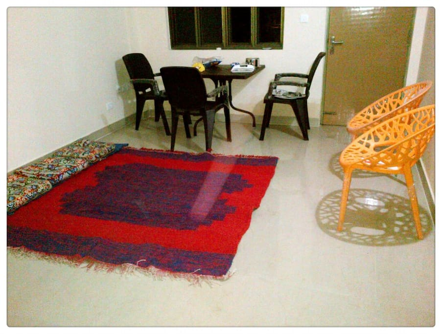 Hall with Dinning set, floor carpet and seating