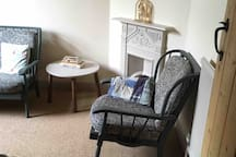 Great room for reading or looking out into the garden . We have a good selection of books .