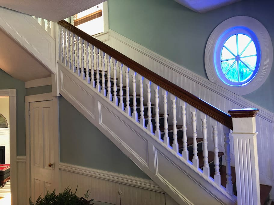 Staircase featuring some of the oldest stained glass in Glynn County