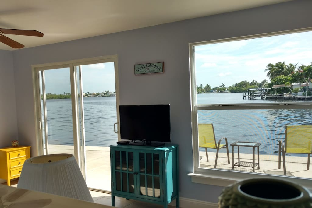 Watch dolphins and manatees from the living room couch