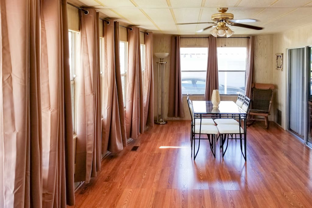 Beat the heat in this sunroom  with hardwood floors!