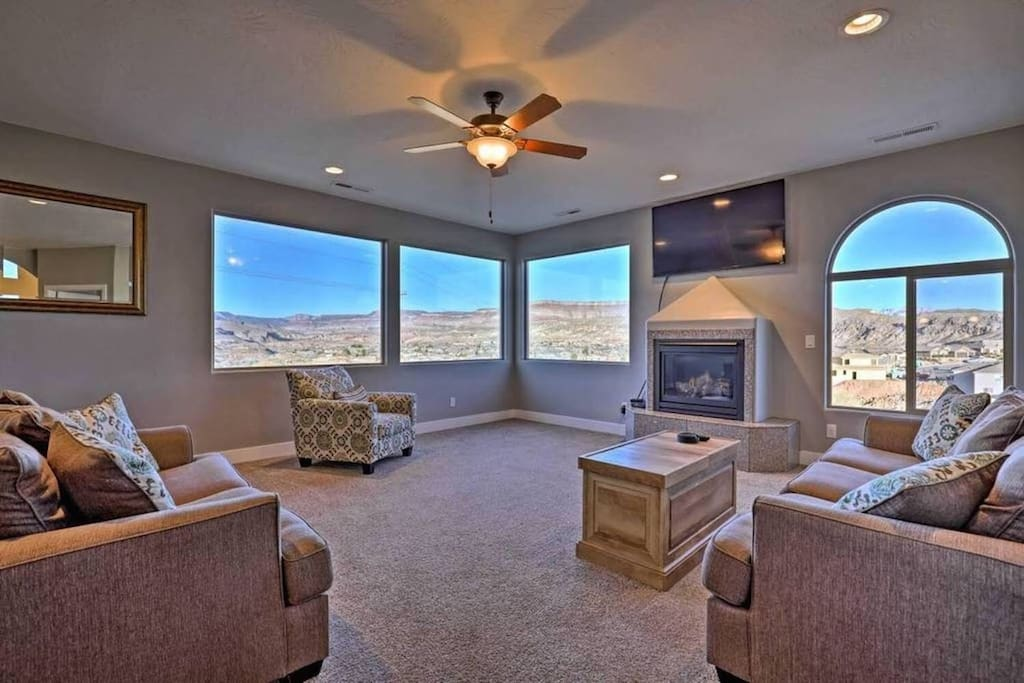 Bright family room with AMAZING VIEWS and cozy fireplace. Perfect for gathering