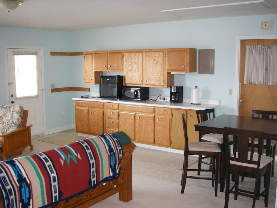 NO KITCHEN, but a small fridge, microwave, coffee pot and an table are available.