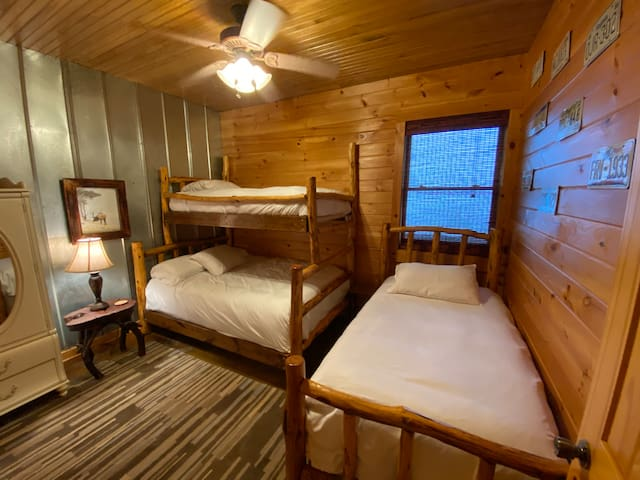 Second bedroom with bunk room style beds hand crafted from local hardwoods.