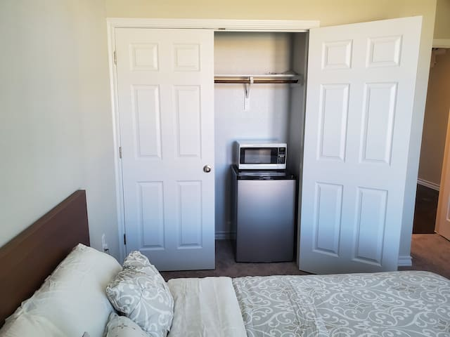 In the closet you will find hangers, a laundry basket, a mini fridge, a trash can and a microwave.