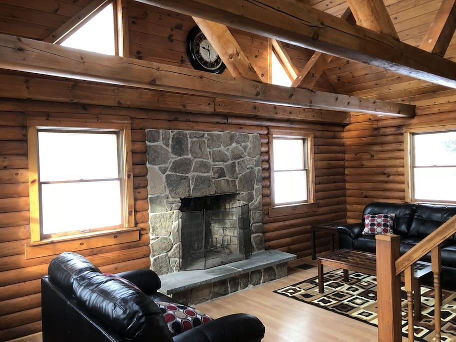 Step into this Vaulted Ceiling Living Room with Fireplace