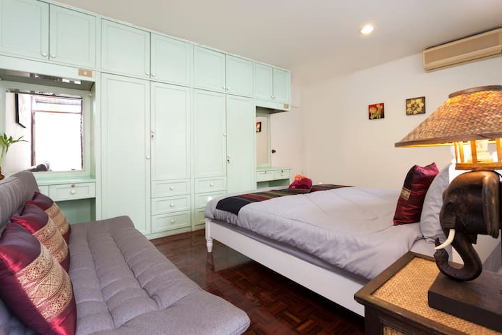 The second bedroom upstairs with plenty of wardrobe space. Come back to get a well earned rest in this cozy and comfy space. Airy & spacious, Ultra comfortable beds, balcony & windows which runs all the way through the room!. Cool A/C