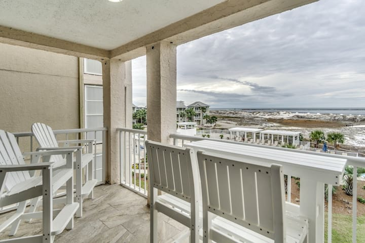 Newly renovated beach view condo with shared pool, grilling areas, close to town