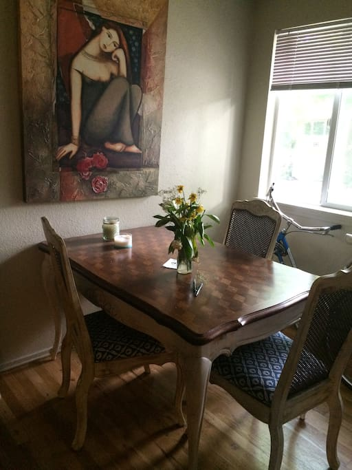 Close up of dining table, has a fourth chair that can be added