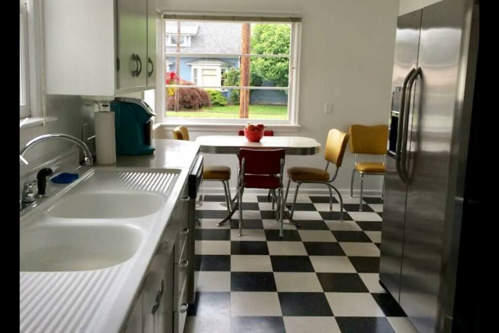 The small, vintage kitchen has just been updated with all new appliances, new paint and new flooring. We want it to be convenient, but still retain the charm of a vintage kitchen.
