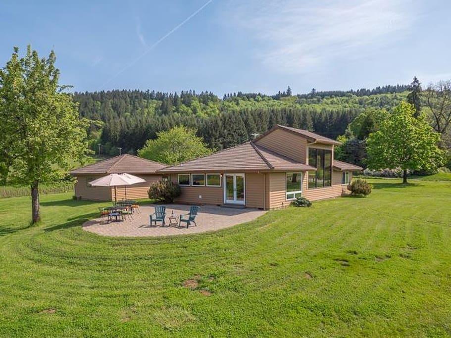 Large backyard patio for enjoying sunsets, mountain and vineyard views.