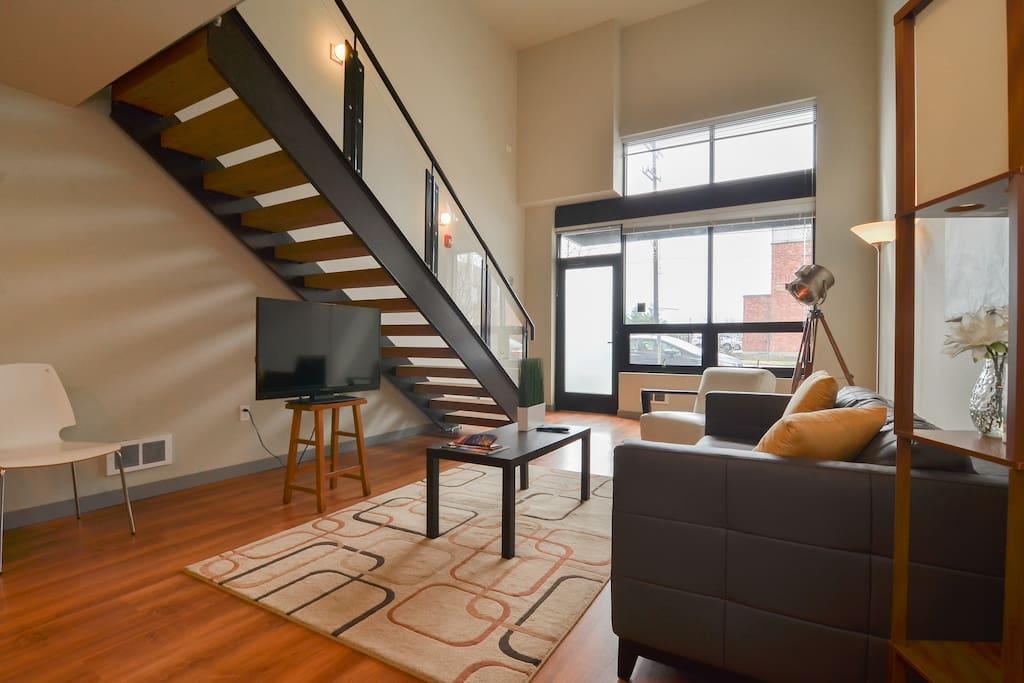 Elegant living space with modern loft.