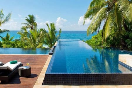 Ocean view pool villa nestled in the trees