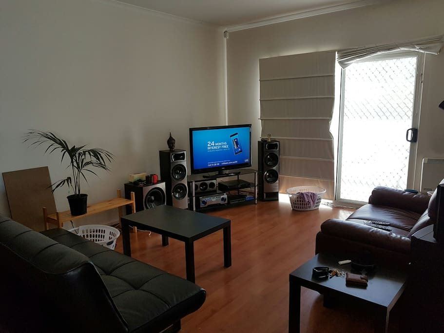 Small lounge room with top of the range couches and sound system