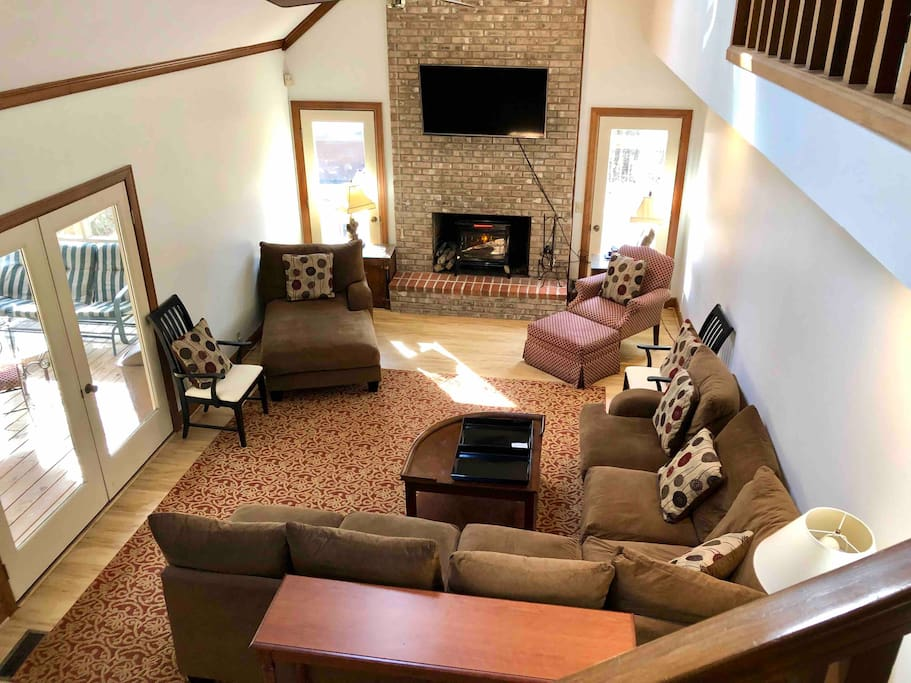 Main living area cathedral ceilings . NATURAL LIGHT. Opens to large new deck with Hot Tub , screen porch and goes into kitchen with a 3 ft entrance