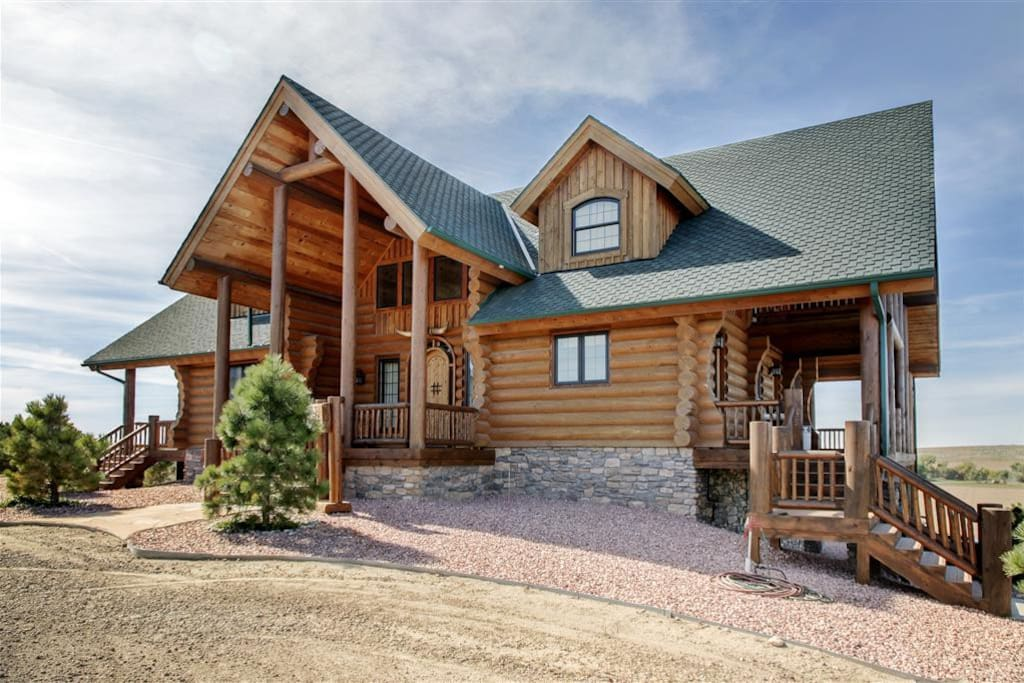 This majestic Atwood vacation rental cabin sits on 80 private acres atop a scenic hill