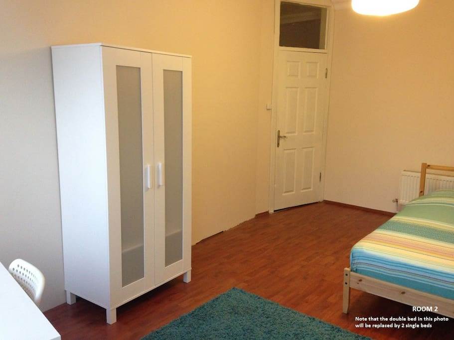 ROOM 102 is a big room having 2 single beds, 2 wardrobes, 2 desks and chairs. In the photos there is one double size bed but it can be replaced by 2 single size beds in the case of demand.