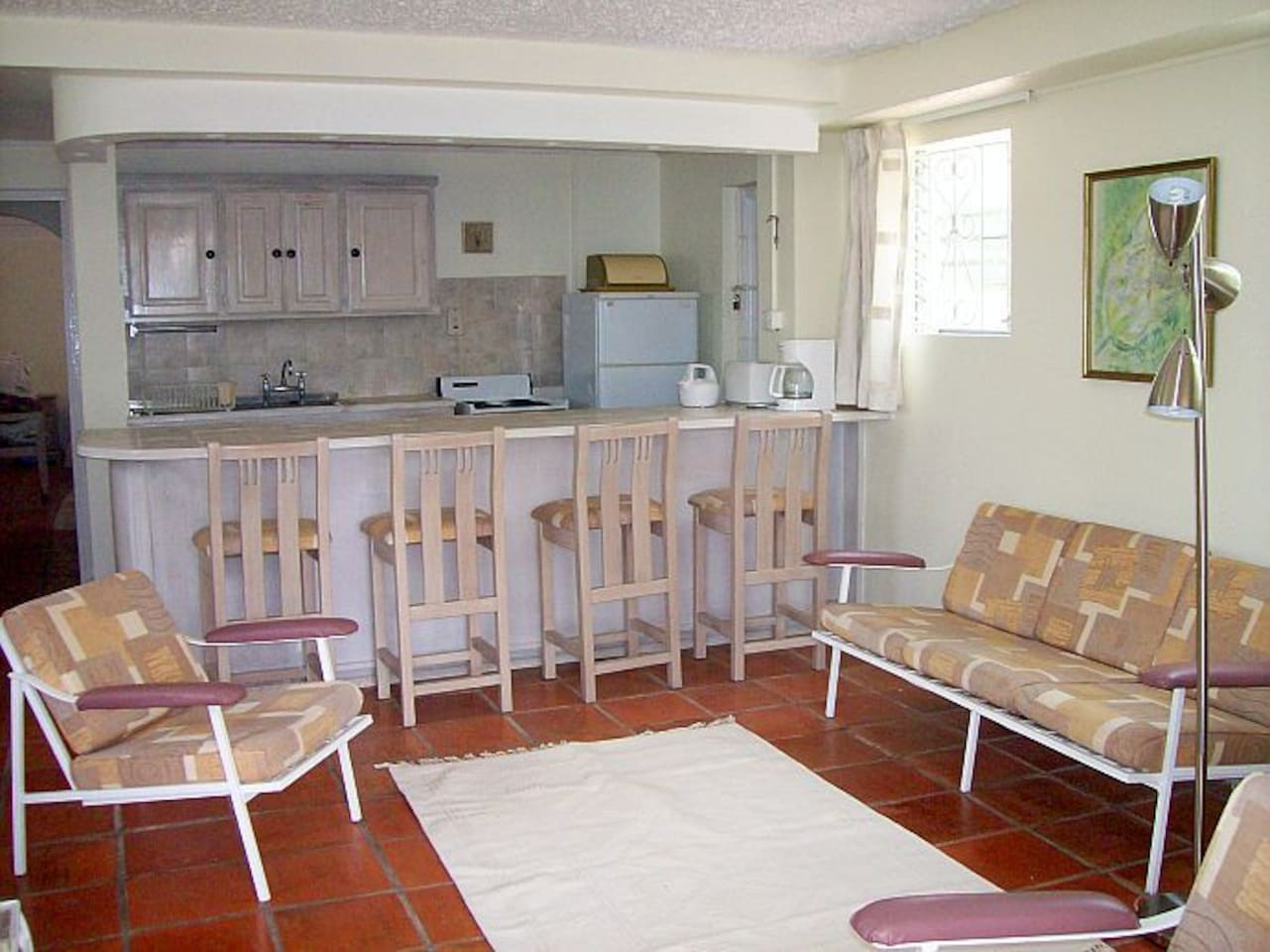 Spacious living area, kitchen with fridge, stove.  There is a stackable washer/dryer in the closet