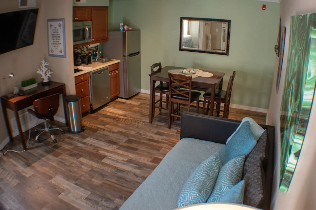 Living room, work-space, dinning table, kitchenette.