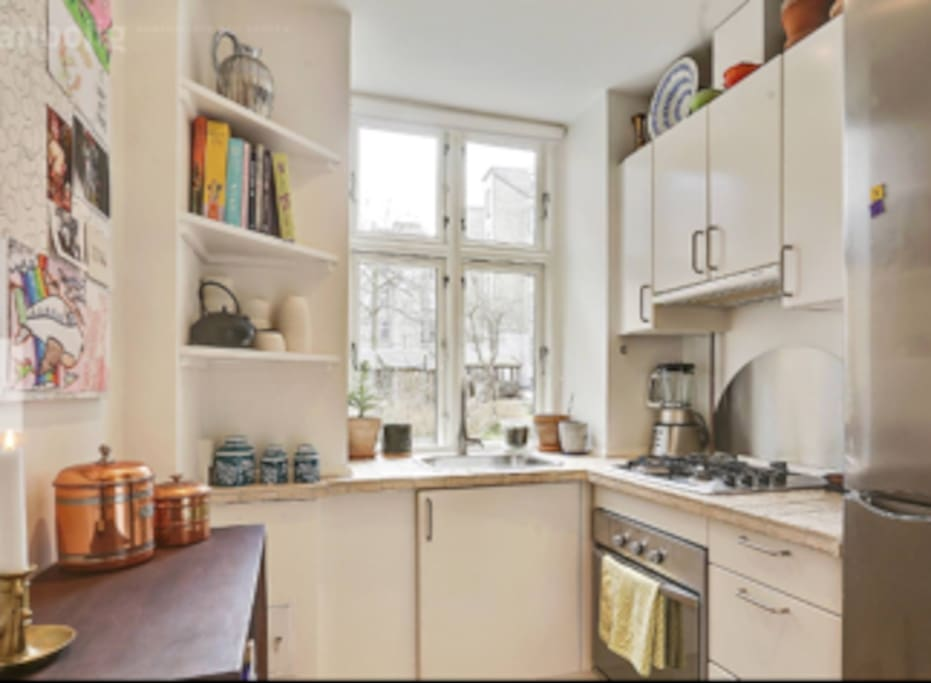 small kitchen. You can put your grocery in the fridge and you can cook your food.